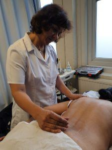 Anjulie doing acupuncture at the fundrasing day